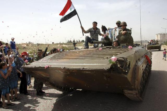people greet Syrian army
