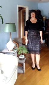 A simple black sweater works well with this black lace pencil skirt.